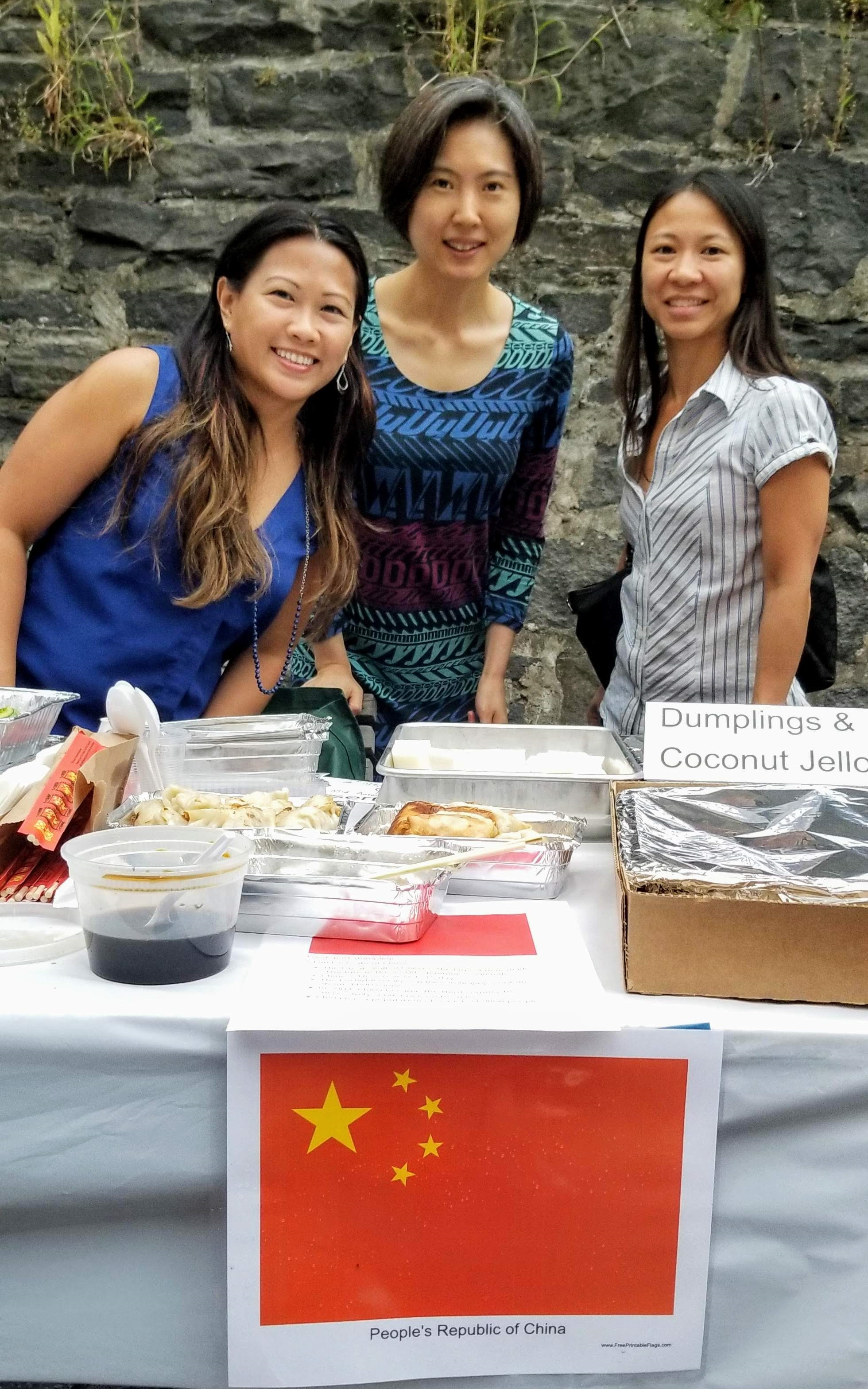 Three parents with a selection of food from China and Chinese Flag
